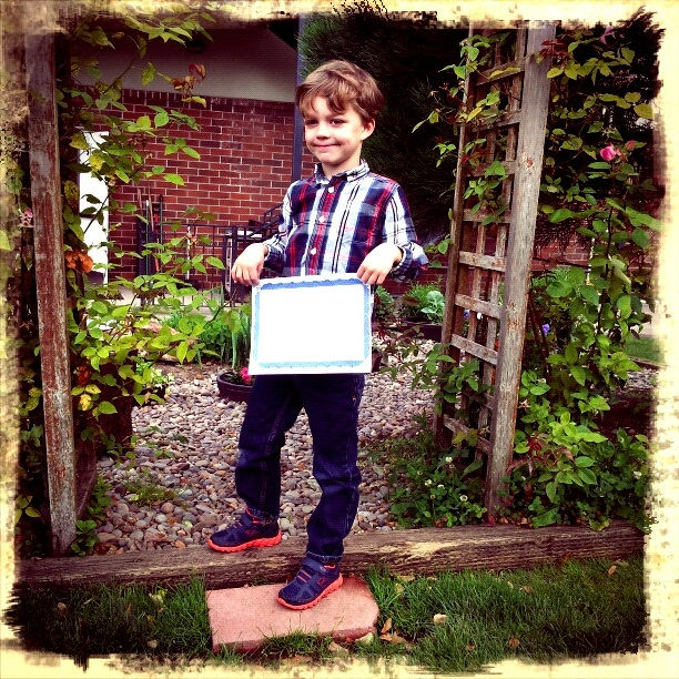 Scholar Lincoln Proudly Displays his Diploma !!
